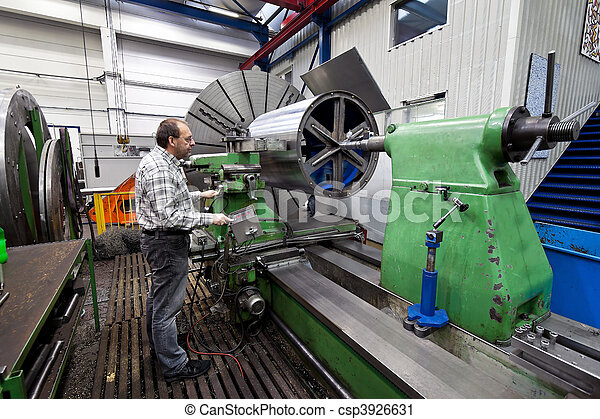 Older workers in the metal industry in CNC milling machine. - csp3926631