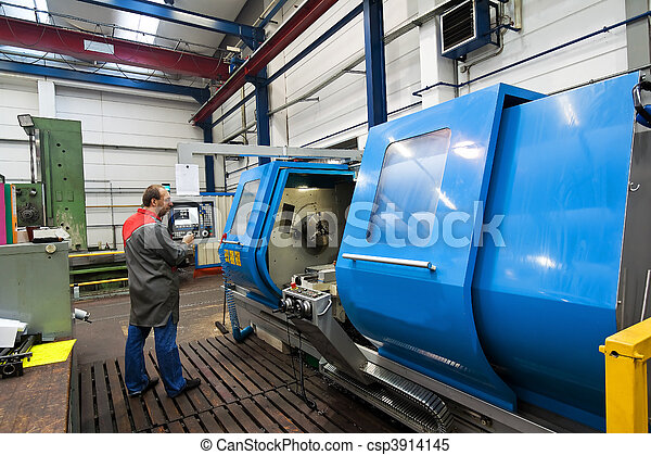 Older workers in the metal industry in CNC milling machine. - csp3914145