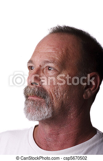 Oler Man with Gray Beard and Mustache Looking at Window Light - csp5670502