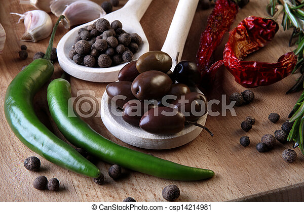 Olive and spices on wooden background - csp14214981