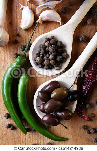 Olive and spices on wooden background - csp14214986