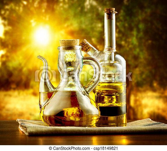 Olivenöl auf dem Tisch im Garten der Olivenbäume - csp18149821