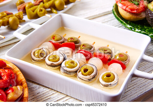 Olives anchovies and picked onion pinchos - csp45372410