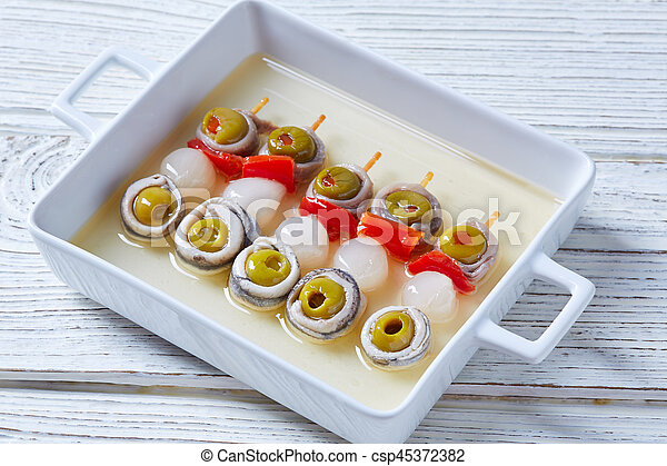 Olives anchovies and pickled onion pinchos - csp45372382