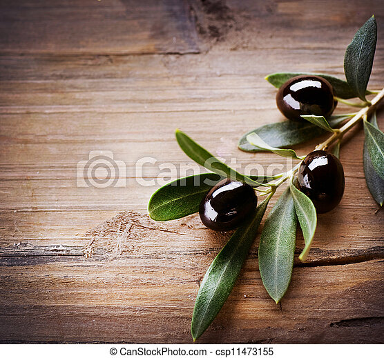 Olives over Wood Background - csp11473155