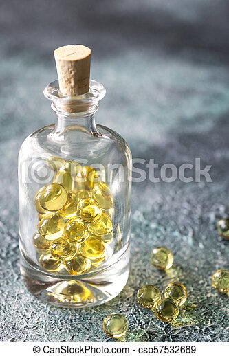 Omega-3 fish oil capsules in the glass bottle - csp57532689