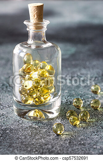 Omega-3 fish oil capsules in the glass bottle - csp57532691