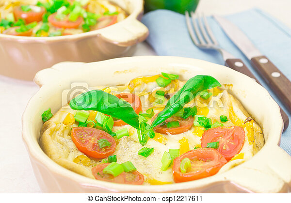 Omelet with herbs and tomatoes - csp12217611