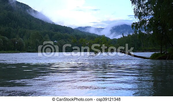 on the shore of a mountain river - csp39121348