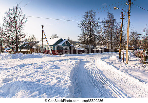 On the street in a Russian village in winter. - csp65500286