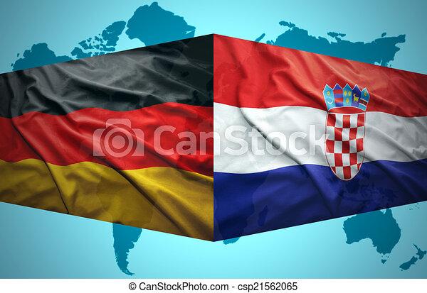 Waving croata y banderas alemanas - csp21562065