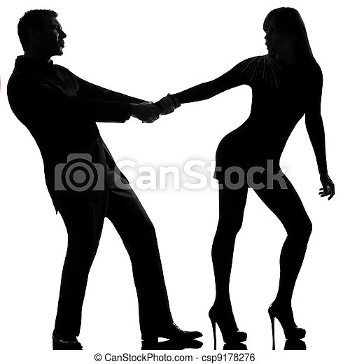 one caucasian couple dispute separation woman leaving and man holding back in studio silhouette isolated on white background - csp9178276