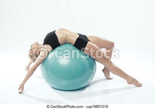one caucasian woman exercising fitness ball workout - csp19851516