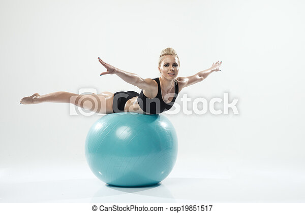 one caucasian woman exercising fitness ball workout - csp19851517