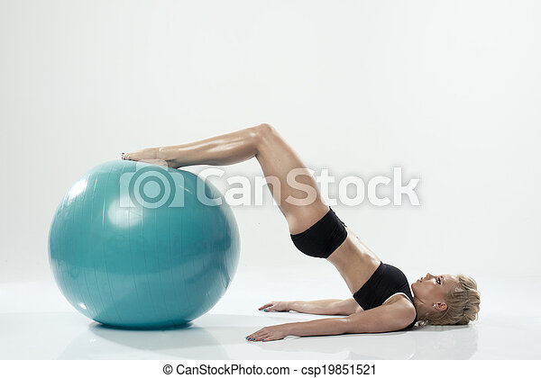 one caucasian woman exercising fitness ball workout - csp19851521