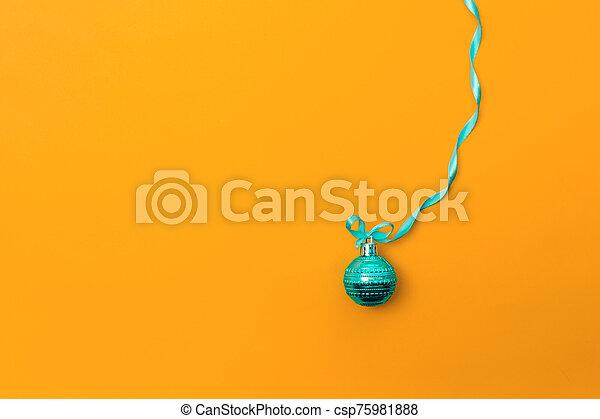One christmas ball on orange background - csp75981888