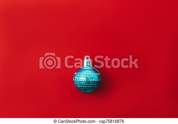 One christmas ball on red background - csp75816876