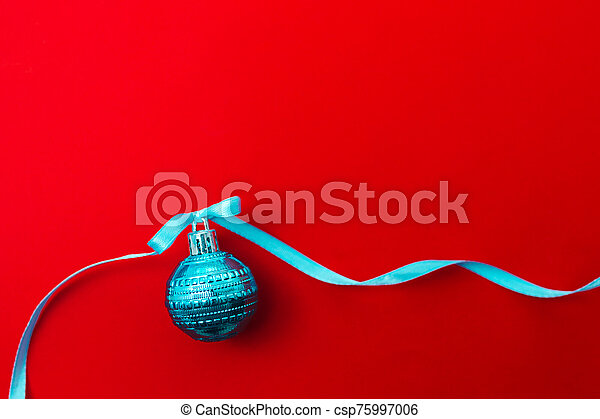 One christmas ball on red background - csp75997006