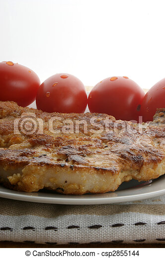 one cutlet with organic tomato on a plate - csp2855144