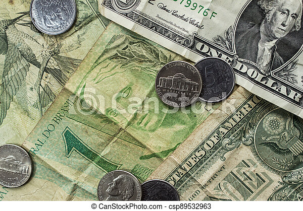 One Dollar notes (USD) and one Real notes (BRL) together with some coins - csp89532963