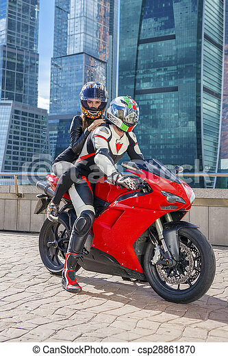 One Guy And Sexy Girl In A Suit With A Motorcycle Sport Bike