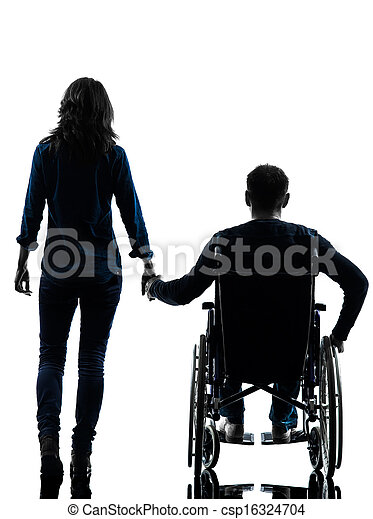 one handicapped man and woman holding hands in silhouette studio  on white background - csp16324704