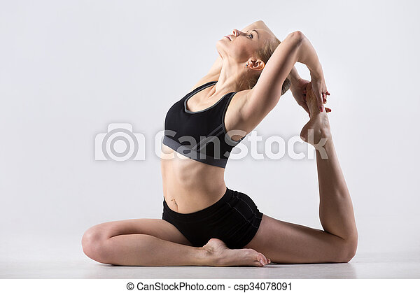 one legged king pigeon pose sporty beautiful young woman