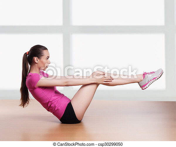 one woman exercising crunches fitness workout arms behind head  - csp30299050