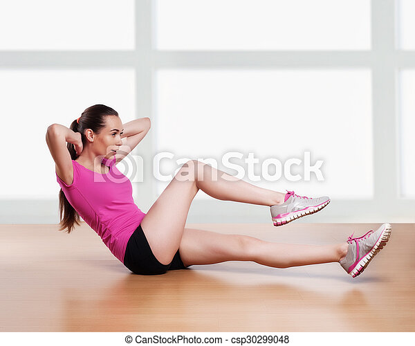 one woman exercising crunches fitness workout arms behind head  - csp30299048
