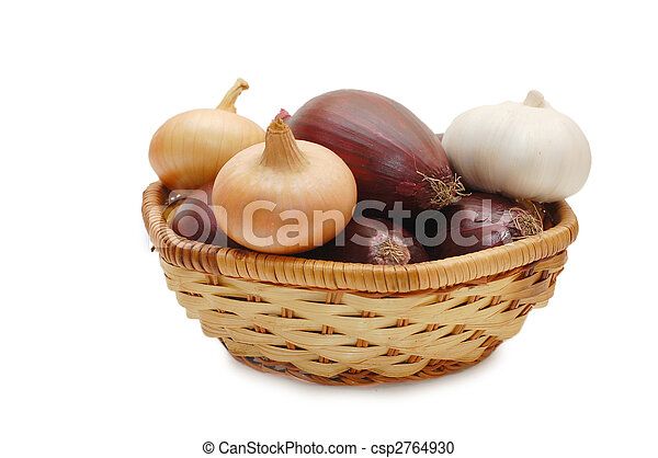 Onions and garlic in a wattled basket - csp2764930