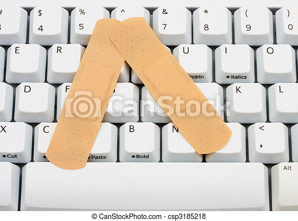 Online Medical Advice Two Bandages On A Computer Keyboard