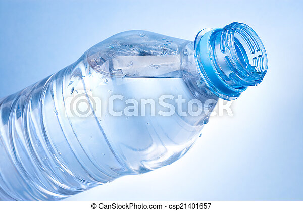 Open a bottle of water on blue background - csp21401657