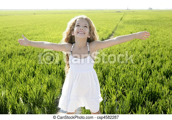 open arms little happy girl green meadow field - csp4582287