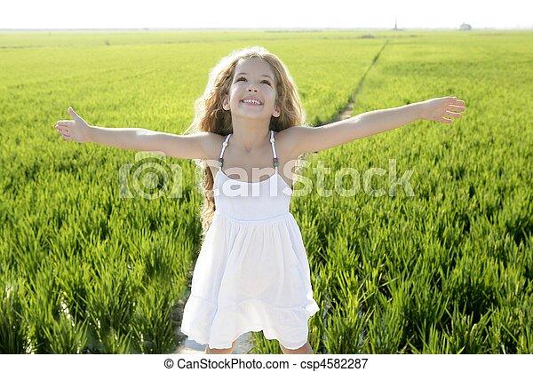 open arms little happy girl green meadow field - csp4582287