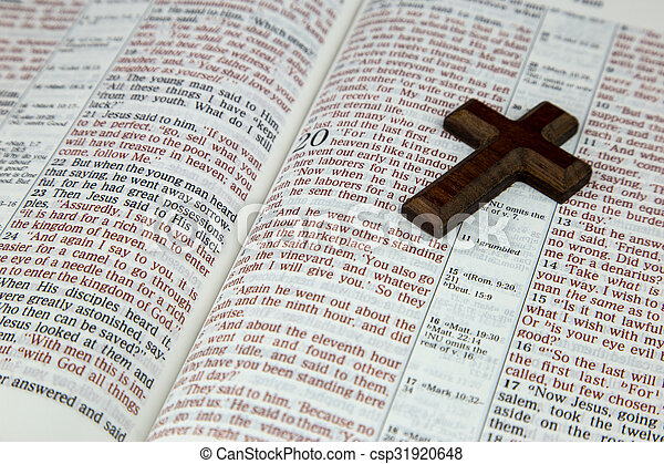 open bible and cross an opened bible and plain wooden cross