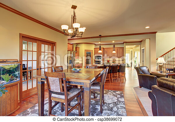 Open floor plan dining area connected to kitchen and living room