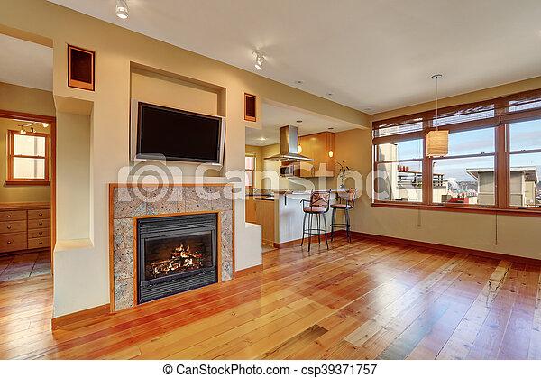 Open Floor Plan View Of Fireplace In The Living Room With Hardwood Floor Northwest Usa Canstock