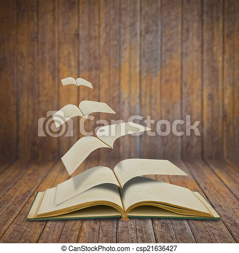 Open flying old books in wood room - csp21636427
