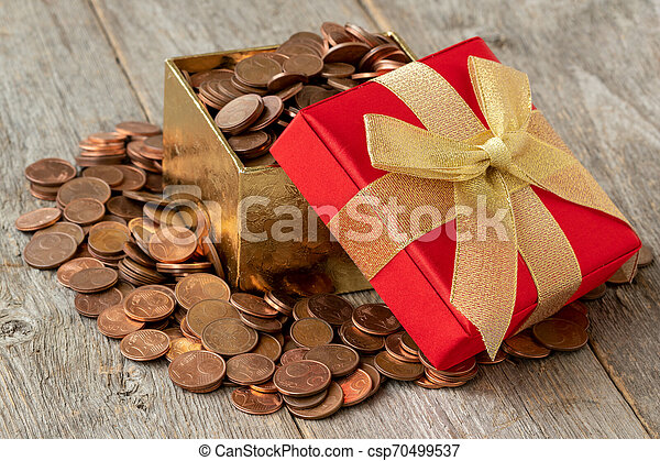 Open gift box full of coins - csp70499537