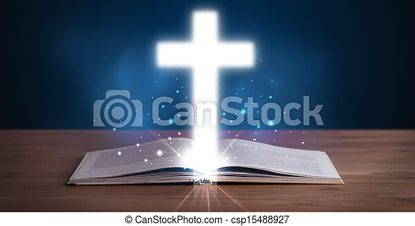 Open holy bible with glowing cross in the middle - csp15488927