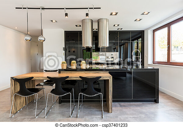 Open kitchen and dining room combined - csp37401233