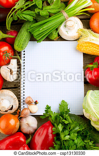 Open Notebook and Fresh Vegetables Background. Diet - csp13130330