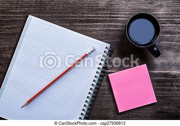 Open notepad pencil reminder note and cup of coffee on wooden bo - csp27936813