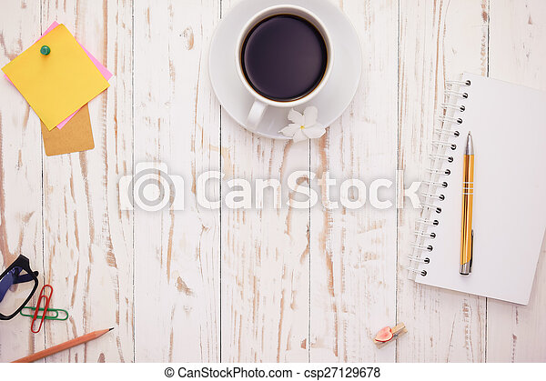 Open Notepad.and cup of coffee with post-it note on white wooden background, with copy space on center area. - csp27129678