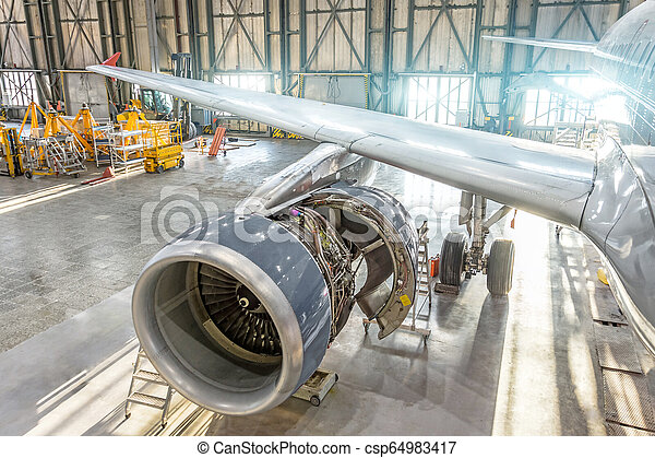 Opened aircraft engine in the hangar, maintenance. Wing view - csp64983417
