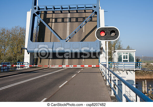 Opened bascule bridge in the Netherlands with red stop sign - csp8207482