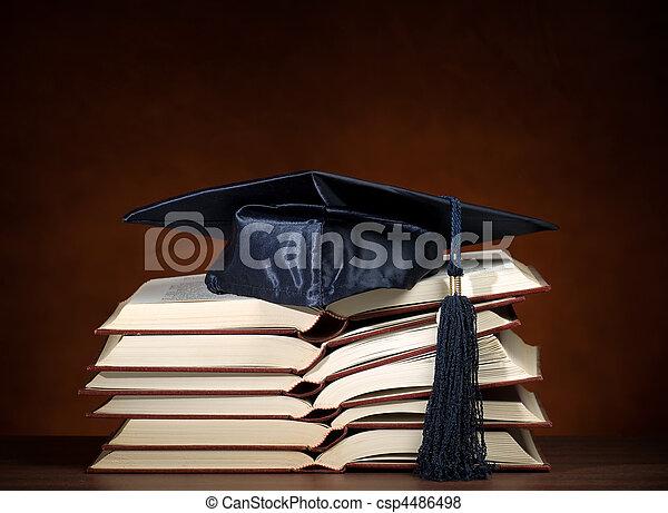 Opened books with graduation cap - csp4486498