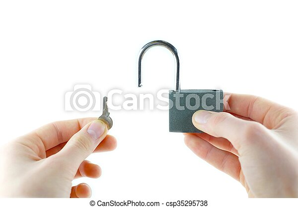 Opened lock and key in hand - csp35295738