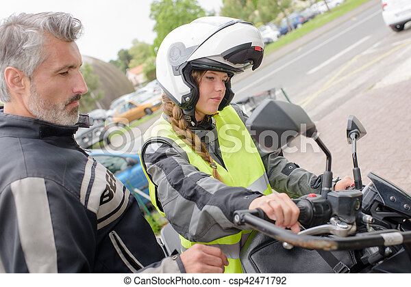 operate a motorcycle - csp42471792
