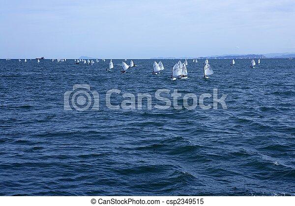 Optimist, recreation little sailboat regatta, Spain - csp2349515